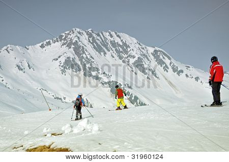 Skiers on the slope in the Austrian Alps