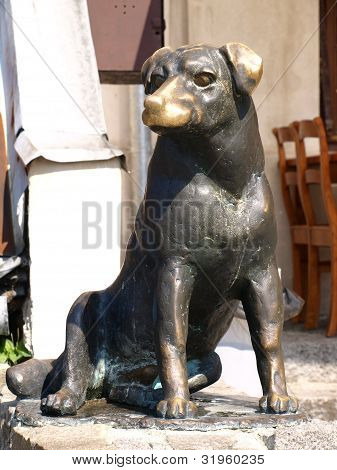 Bronze statue of dog in Old Market Place in Kazimierz Dolny, Poland