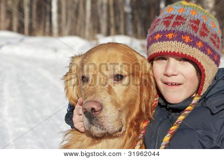 Portrait Of The Boy And Golden Retriever In The Nature