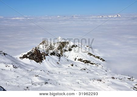 Clouds And Fog Above, Beautiful Sunny Winter Landscape In The Alps