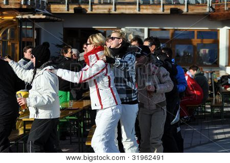 Skiers at a party in the Austrian Alps
