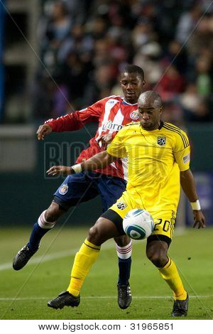 CARSON, CA. - APRIL 9: Columbus Crew F Emilio Renteria #20 & Chivas USA M Michael Lahoud #11 during the MLS game between Columbus Crew & Chivas USA on April 9 2011 at the Home Depot Center.