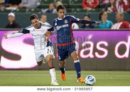 CARSON, CA. - APRIL 30: New England Revolution M Benny Feilhaber #22 (L) & Chivas USA D Mariano Trujillo #8 during the MLS game on April 30 2011 at the Home Depot Center.