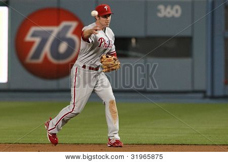 LOS ANGELES - AUG 31: Phillies 2B (26) Chase Utley fields a ground ball and throws during the MLB game on Aug 31 2010 at Dodgers Stadium