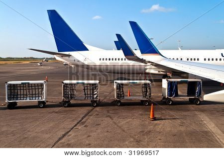 Airplanes on a airplane with luggage cars