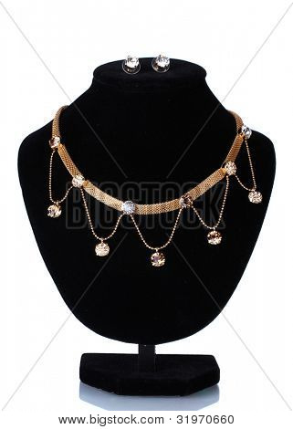 beautiful golden necklace  and earrings on mannequin isolated on white