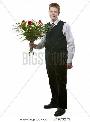 The pupil in a school uniform with a bouquet of flowers