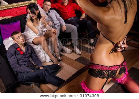 Crazy wedding party in night club.