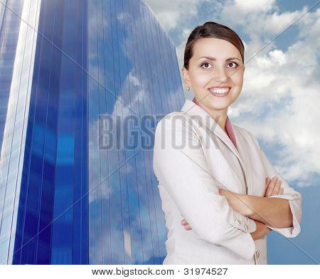 Businesswoman On The Bright Blue Office Building Background