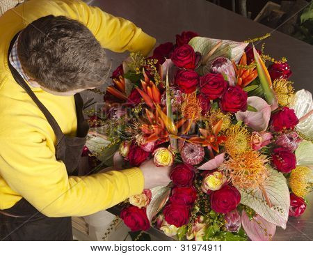 Florist arranging fresh flowers