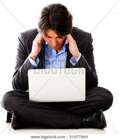 Worried business man working with a laptop computer - isolated over white