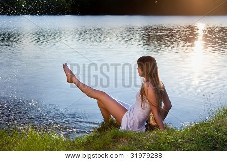 cute young woman  on water background