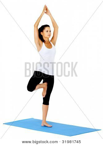 Young woman does yoga on mat. This is part of a series of various yoga poses by this model, isolated on white