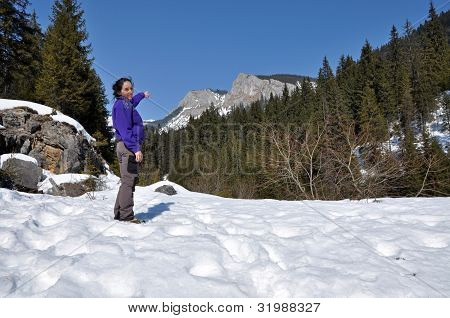 Young woman at winter in the mountains