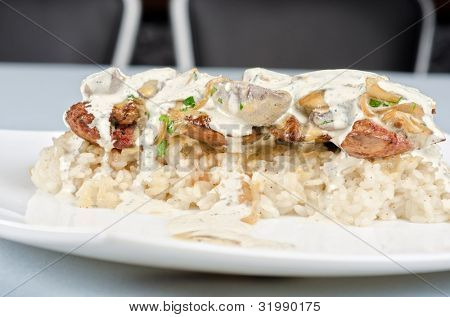 risotto with chicken liver, champignons and sauce