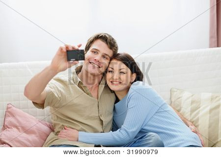 Smiling Young Couple Making Self Photo