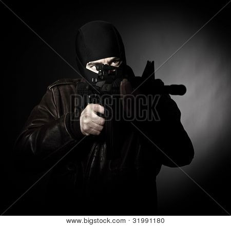 portrait of criminal with m4 rifle