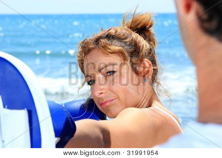 Couple traning boxing on the beach