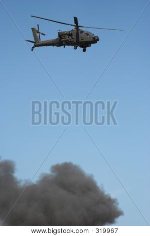 Apache Helicopter In Flight In A Warzone