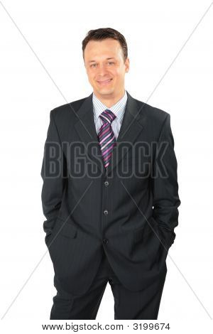 Smiling Businessman In Black Suit