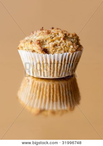 Gluten Free Muffin With Nuts On Golden Background