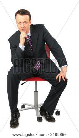 Businessman Sits In Office Chair