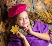 Fashion Hat Trend Fall Season. Girl Cute Child In Knitted Hat Lay Wooden Background Fallen Maple Lea poster
