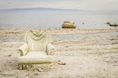 A Discarded Chair On The Shores Of Salton Sea, California poster