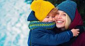 Happy Winter. Mom And Baby Warm Hat Scarf. Woman With Son Smiling Snowy Winter Nature Background. Ch poster