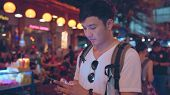 Traveler Asian Blogger Men Travel In Bangkok, Thailand, Male Using Mobile Phone Checking Social Medi poster