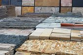 Construction Materials. Natural Stone For Decoration In Construction Is Sold On Market. Building Roc poster