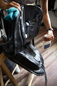 Cleaning And Maintenance Of The Saddle. The Woman Rider Cares For The Saddle poster