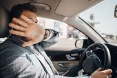 Young Driver Hides His Face And Looks Scared Because Of Dangerous Traffic Situation That Could Cause poster