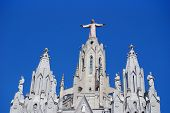 stock photo of omnipresent  - Christ at Tibidabo Church in Barcelona Spain - JPG