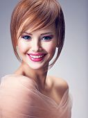Beautiful smiling redhead girl with style hairstyle. Portrait of a sexy young woman  with big blue e poster