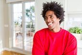 African American man wearing casual red sweatshirt smiling looking side and staring away thinking. poster
