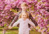 Couple Adorable Lovely Kids Walk Sakura Garden. Tender Love Feelings. Little Girl And Boy. Romantic  poster