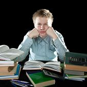 image of teenage boys  - The teenager with a heap of textbooks - JPG