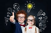 Happy Smart Little Girl And Boy Student With Lightbulb On Blackboard Background. Brainstorming And I poster