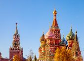Spasskaya Tower Kremlin And Saint Basil Cathedral Red Square In Moscow, Russia Autumn poster