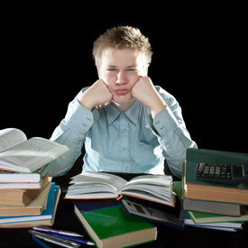 foto of teenage boys  - The teenager with a heap of textbooks - JPG