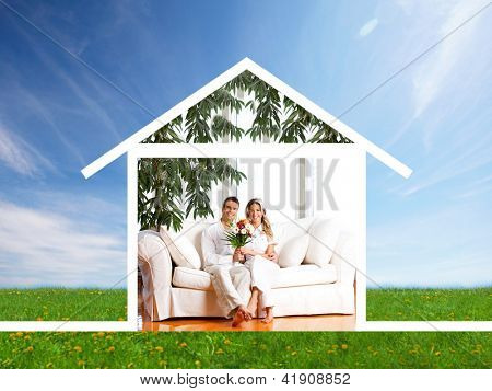 Happy family at home. Real estate and construction concept.