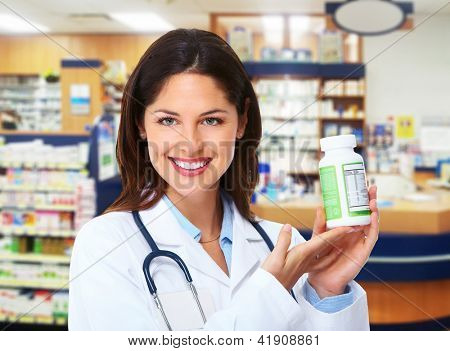 Pharmacist woman with drugs in a pharmacy.
