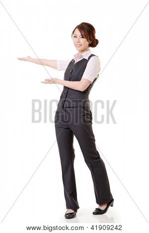 Asian business woman showing and introducing, full length portrait isolated on white background.