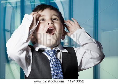 Child dressed businessman with funny face. surprise