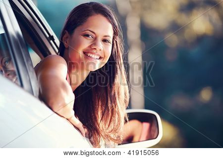 carefree woman driving car on vacation happy smile holiday