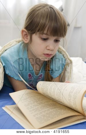Little Girl Is Reading Book