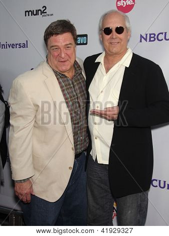 LOS ANGELES - AUG 02:  JOHN GOODMAN & CHEVY CHASE arriving to Summer 2011 TCA Party - NBC  on August 02, 2011 in Beverly Hills, CA