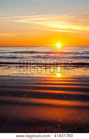 Sunrise at a beach with sand