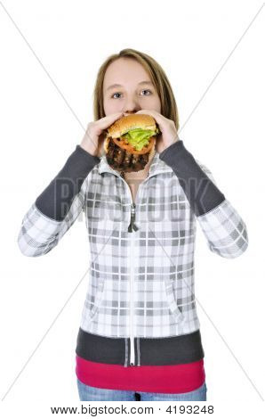 Teenage Girl Eating Big Hamburger